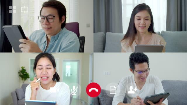 vidéos et rushes de interface utilisateur de vidéoconférence de l'équipe d'affaires parlant dans l'appel vidéo à la maison. équipe asiatique utilisant l'ordinateur portable et la tablette réunion en ligne dans l'appel vidéo. travailler à domicile, travaille - conférence en ligne