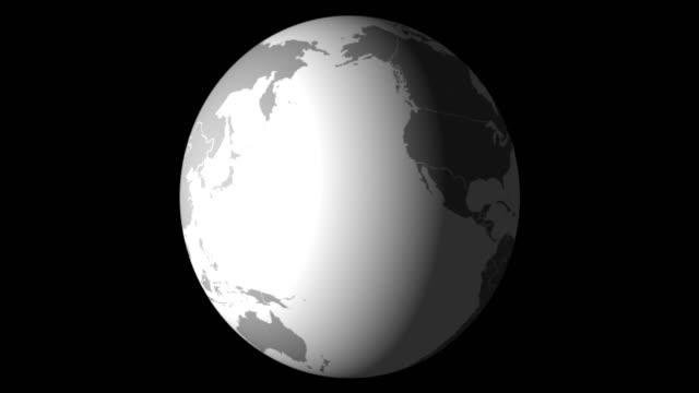 Vidéo 4K. Jour de la terre. La planète Erath en mouvement. La carte du monde sur fond noir. - Vidéo