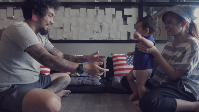 4K Video - Family with baby learning to walk Asian family with baby learning to walk at the living room in Thailand. first occurrence stock videos & royalty-free footage