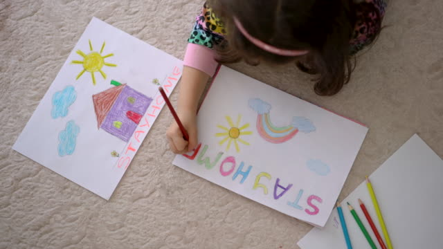 4K Video footage of a cute little girl drawing pictures at home, Stay at home concept