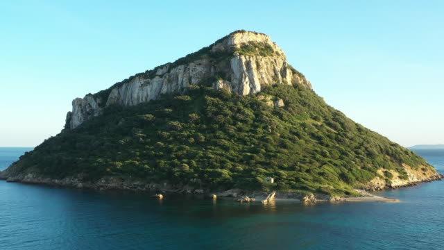 video from above, aerial view of a beautiful figarolo island located north-east of sardinia, italy. - grass isolated video stock e b–roll