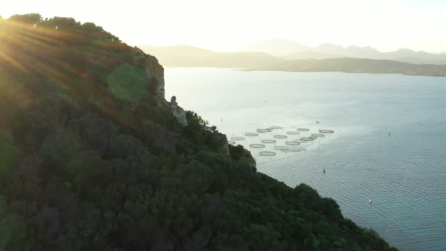 Video from above, aerial view of a fish farm located in Golfo Aranci, north-east of Sardinia, Italy