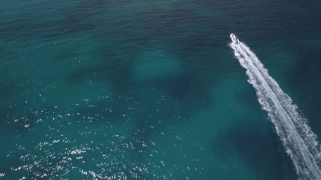 Video from above. Aerial view of a little boat on the Emerald Coast, Sardinia, Italy video