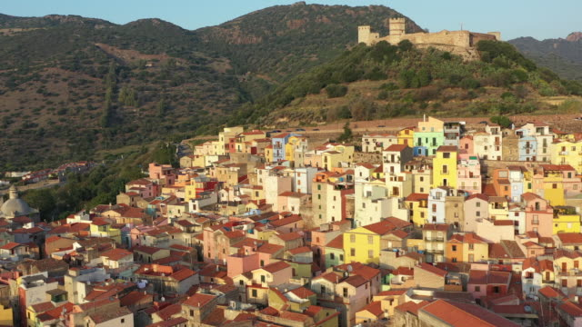 video from above, aerial view of the beautiful village of bosa with colored houses and a medieval castle. bosa is located in the north-wesh of sardinia, italy. - sardegna video stock e b–roll