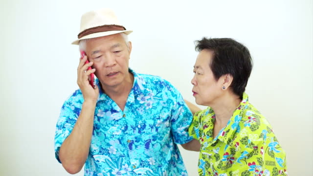Video Frustrated Asian couple have problem on holiday trip. Aggressive phone call complain and upset video