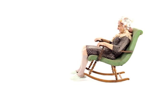HD Video funny senior woman grandma fun on rocking chair HD Video funny senior woman grandma fun on rocking chair rocking chair stock videos & royalty-free footage