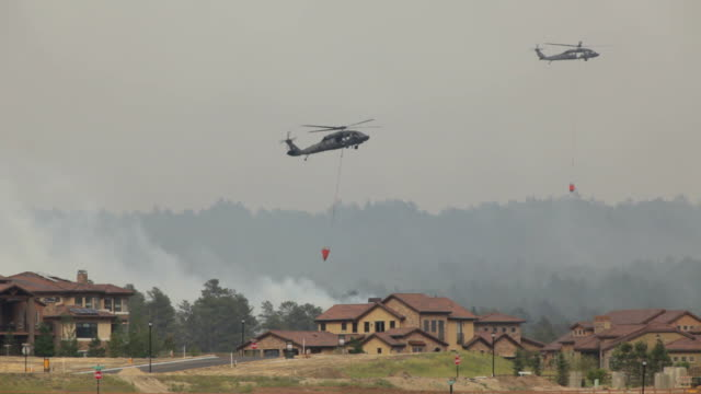 hd video helicopters water drop on colorado springs wildfire - house after fire bildbanksvideor och videomaterial från bakom kulisserna
