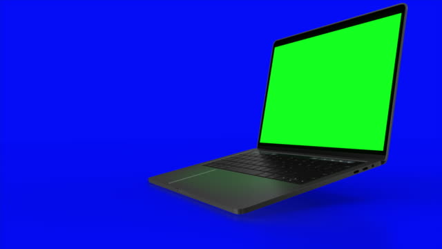 4K Video. Laptop (Notebook) Turning On With green Screen On A blue Background.