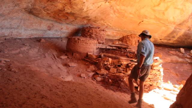 HD video man explores ancient Pueblo ruins Utah video