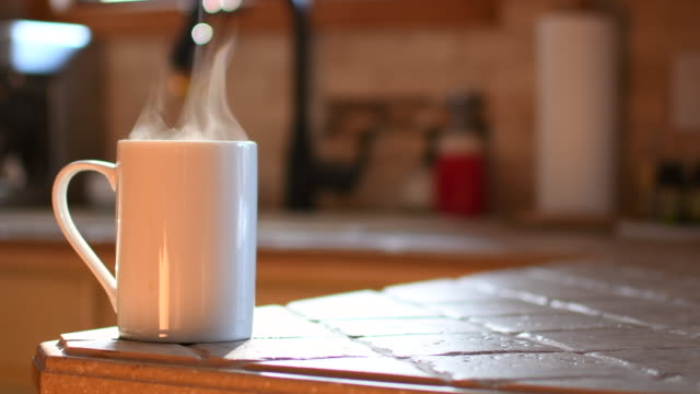 Video of a coffee cup in the sunlight.