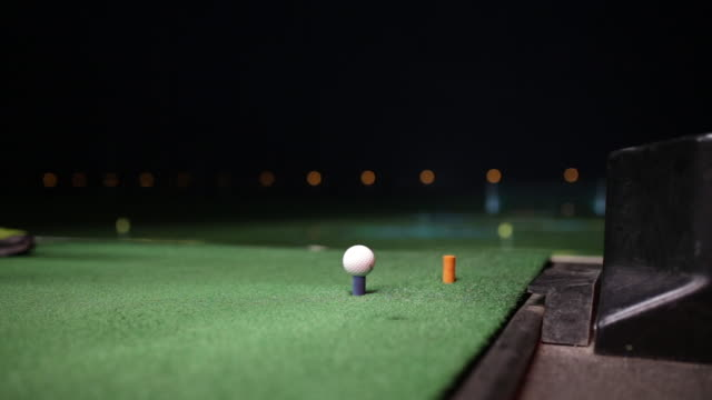 Video Of A Golfer Hitting The Golf Ball At Night