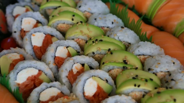 Video of a platter of sushi rolls with both raw and cooked ingredients 1080p HD video