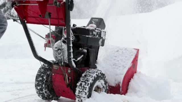 4K Video of a Senior Man Using SnowBlower After a Snowstorm