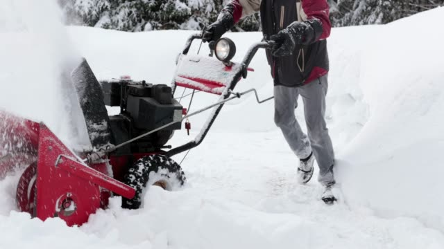 4K Video of a Senior Man Using SnowBlower After a Snowstorm 4K Video of a Senior Man Using SnowBlower After a Snowstorm, Quebec, Canada plow stock videos & royalty-free footage