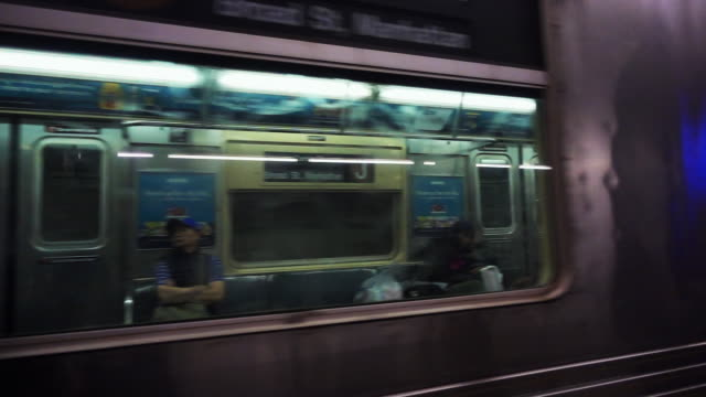 Video of a train with people on board arriving in the New York subway. Video of a train with people on board arriving in the New York subway. railroad station platform stock videos & royalty-free footage