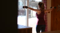 istock Video of a woman training at home. 1215060046