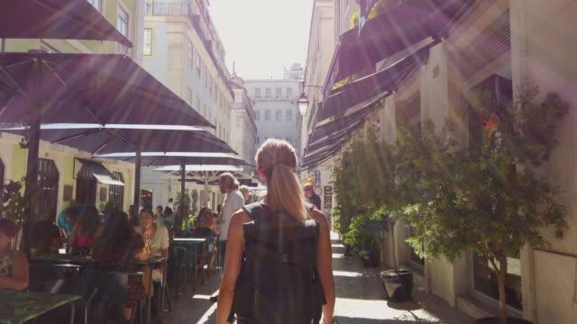 Video of a woman visiting Lisbon.