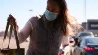 istock Video of a woman wearing a face mask at the grocery store. 1217895132
