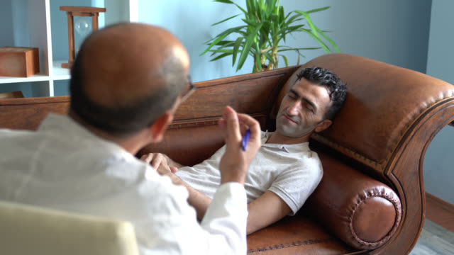 UHD Video Of Adult Man Lying On Psychiatrist Couch While having Therapy video