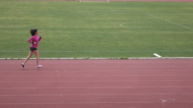 UHD Video Of Adult Woman With Long Hair Running In Stadium video