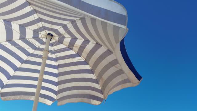 Video of beach umbrella in 4K video
