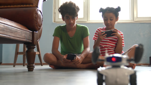 4K Video Of Brother And Sister Playing With Robotics video