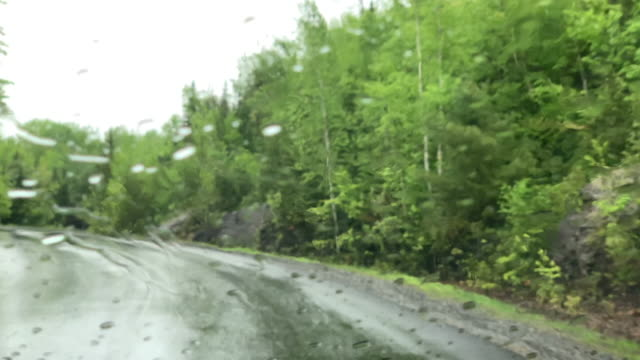 4K POV Video of Car driving on a Mountain Forest Road on rainy day, Quebec, Canada