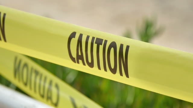 Video of caution tape in 4K High quality video of caution tape in 4K crime scene stock videos & royalty-free footage