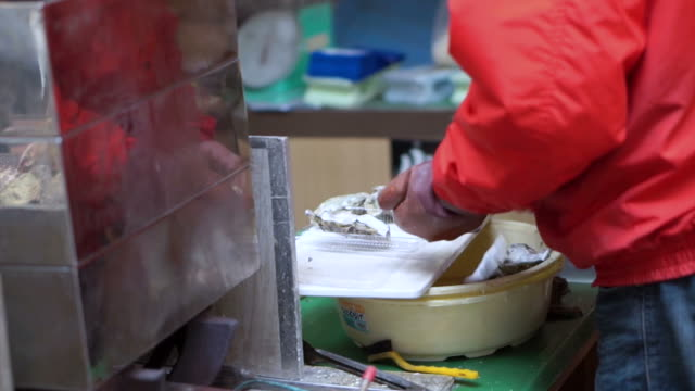 Video of chef opening of oysters at in fish market video