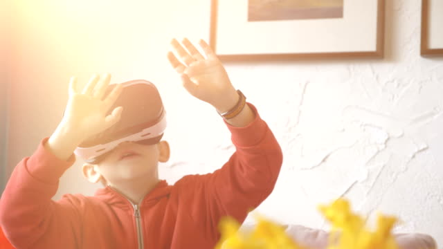 Video of child exploring virtual reality and playing games in 4k slow motion video