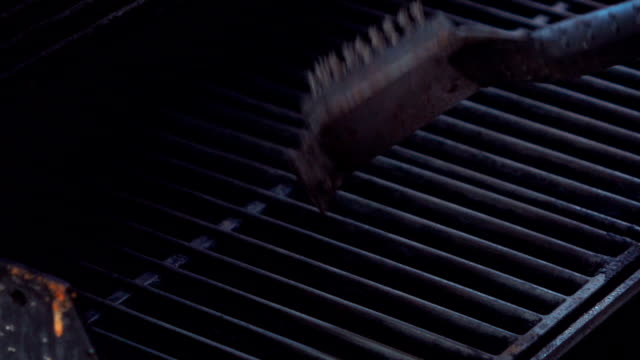 Video of cleaning grill in real slow motion video