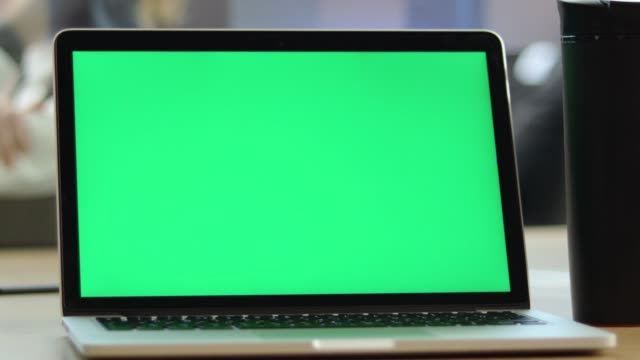 4K Video Of Close-up Man Using Chroma Key Screen Laptop Computer on desk at office