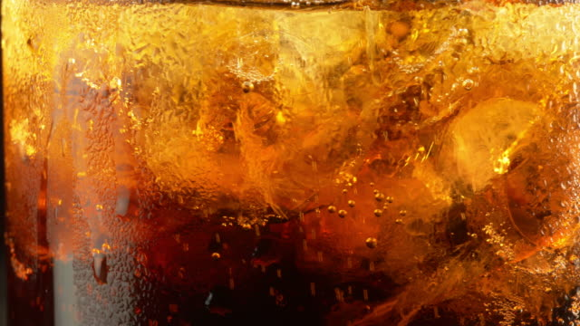 Video of cold Cola with ice cubes in 4K video