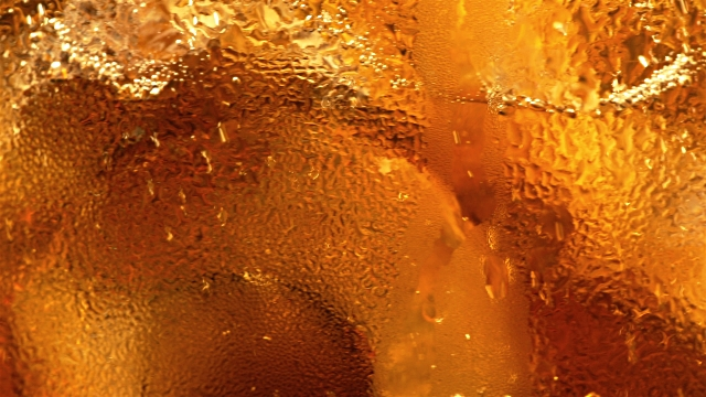 Video of cold cola with ice cubes in 4K