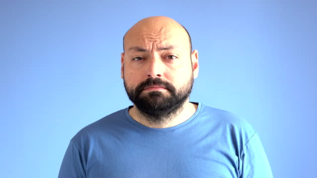 UHD Video Of Compilation Of Facial Expressions Of Adult Man On Blue Background video