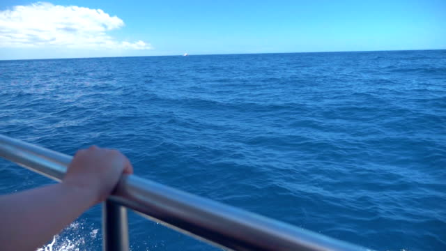Video of deck of a sailboat sailing on the ocean in real slow motion video