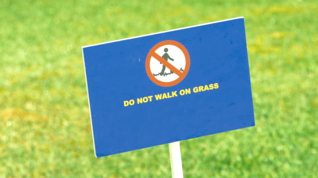 Video of do not walk on grass sign in 4K video