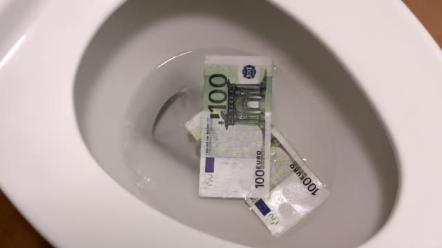 Video of flushing euro banknotes in toilet bowl in 4K video