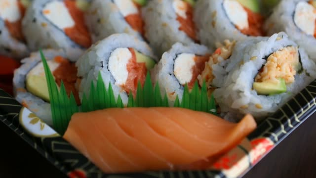 Video of fresh sushi rolls prepared with both raw and cooked ingredients 1080p video