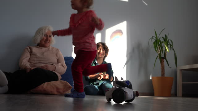 Video Of Grandmother And Grandchildren Playing With Toy Robot In Living Room video
