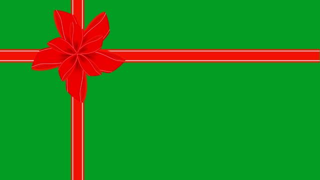 stockvideo's en b-roll-footage met video van groene gift card met rood lint - birthday gift voucher