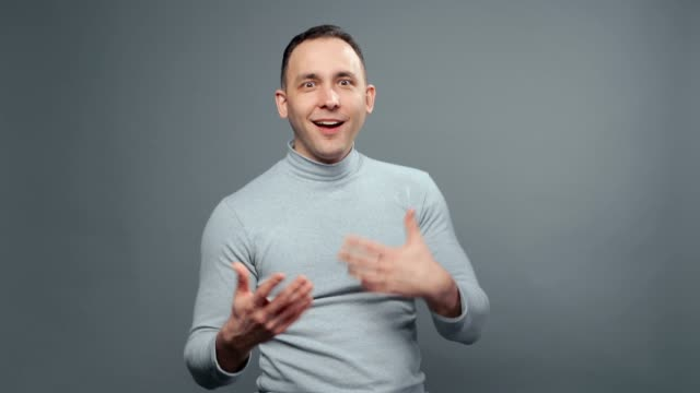 Video of grimacing man in turtleneck Video of young man in turtleneck on grey background vanity stock videos & royalty-free footage