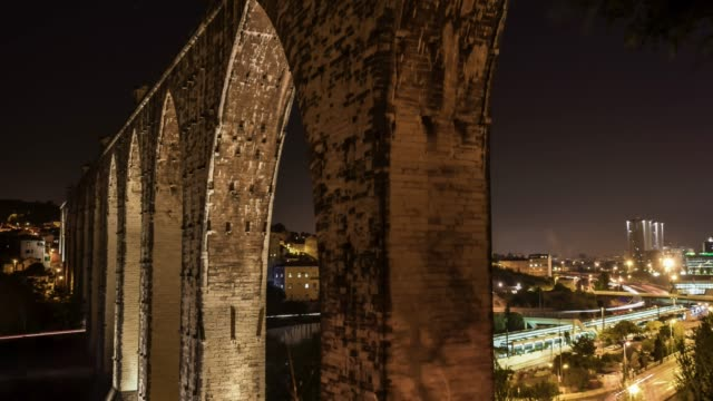 Video of highway at night UHD Long exposure timelapse video of highway IP7 passing under The Águas Livres Aqueduct of Lisbon. aqueduct stock videos & royalty-free footage