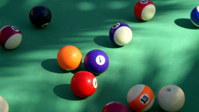 Video of hitting billiards balls on the table in 4k video
