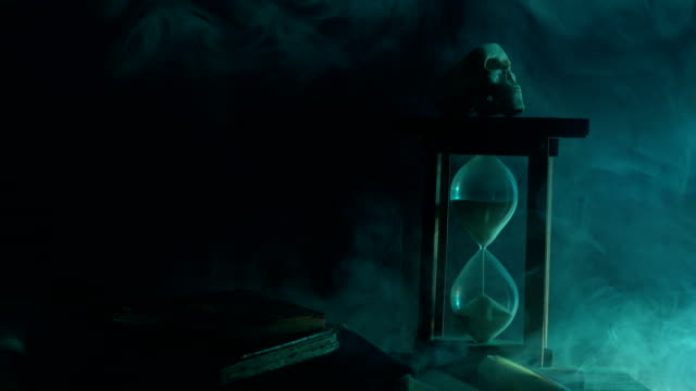 UHD Video Of Hourglass, Human Skeleton and Magic Book For Halloween video