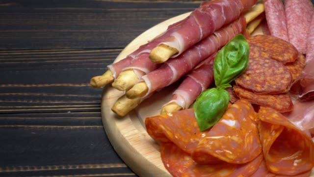 Video of italian meat plate - sliced prosciutto, sausage and grissini video