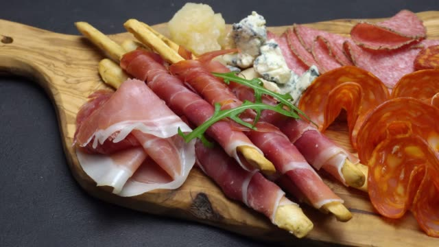 Video of italian meat plate - sliced prosciutto, sausage, grissini and parmesan video