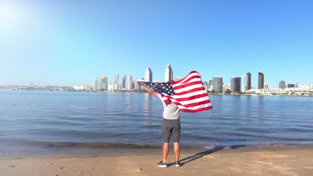 video of man holding american flag in real slow motion - memorial day stock videos and b-roll footage