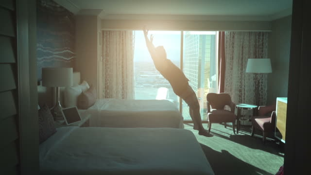 Video of man jumping on the bed in real slow motion video