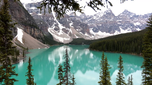 4K Video of Moraine Lake at sunrise in June, Banff National Park, Canada
